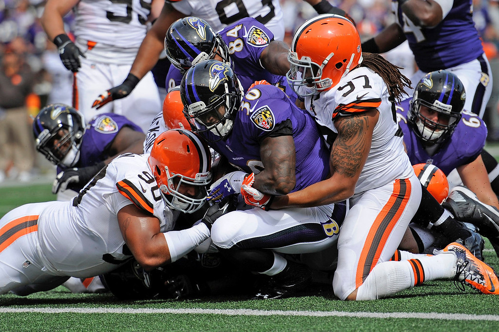 . Baltimore Ravens running back Bernard Pierce powers his way into the end zone for a touchdown as Cleveland Browns defensive end Billy Winn (90) and outside linebacker Jabaal Sheard (97) try to stop him during the second half of an NFL football game in Baltimore, Md., Sunday, Sept. 15, 2013. (AP Photo/Nick Wass)