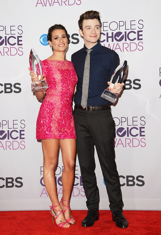 Description of . (L-R) Actress Lea Michele, winner of Favorite TV Comedy Actress, and actor Chris Colfer, winner of Favorite TV Comedy Actor, pose in the press room at the 39th Annual People\'s Choice Awards at Nokia Theatre L.A. Live on January 9, 2013 in Los Angeles, California.  (Photo by Jason Merritt/Getty Images)