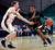 Texas State's Phil Hawkins (0) drives the ball around Denver's Chase Hallam during the first half of a Western Athletic Conference tournament NCAA college basketball game on Thursday, March 14, 2013, in Las Vegas. (AP Photo/David Becker)