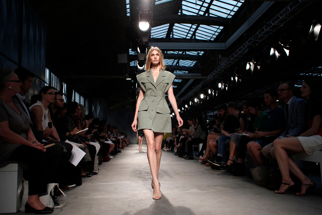 Description of . A model presents a creation as part of Portuguese fashion designer Felipe Oliveira Baptista's ready-to-wear Spring/Summer 2014 fashion collection presented in Paris, Wednesday, Sept. 25, 2013. (AP Photo/Thibault Camus)