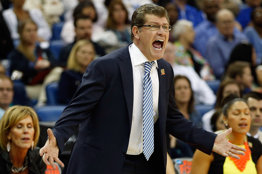 Description of . Head coach Geno Auriemma of the Connecticut Huskies reacts during the game against the Notre Dame Fighting Irish during the National Semifinal game of the 2013 NCAA Division I Women\'s Basketball Championship at the New Orleans Arena on April 7, 2013 in New Orleans, Louisiana.  (Photo by Chris Graythen/Getty Images)