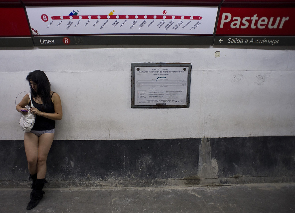 ". A woman taking part in the ""No Pants Subway Ride\"" waits at a metro station in Buenos Aires on January 12, 2014. \""No Pants Subway Ride\"" is an annual event in which transit passengers ride trains without wearing pants in January. The event is observed in dozens of cities worldwide.   ALEJANDRO PAGNI/AFP/Getty Images"