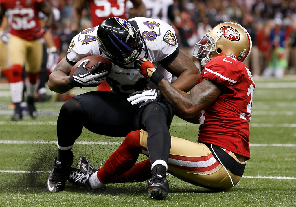 Description of . San Francisco 49ers strong safety Donte Whitner (31) is called for a face mask penalty as he brings down Baltimore Ravens tight end Ed Dickson (84) during the second quarter in the NFL Super Bowl XLVII football game in New Orleans, Louisiana, February 3, 2013. REUTERS/Mike Segar