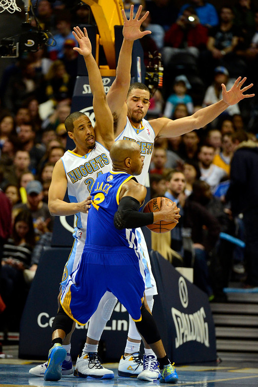 Description of . Golden State Warriors point guard Jarrett Jack (2) is pressured by Denver Nuggets point guard Andre Miller (24) and center JaVale McGee (34)  during the first half at the Pepsi Center on Sunday, January 13, 2013. AAron Ontiveroz, The Denver Post