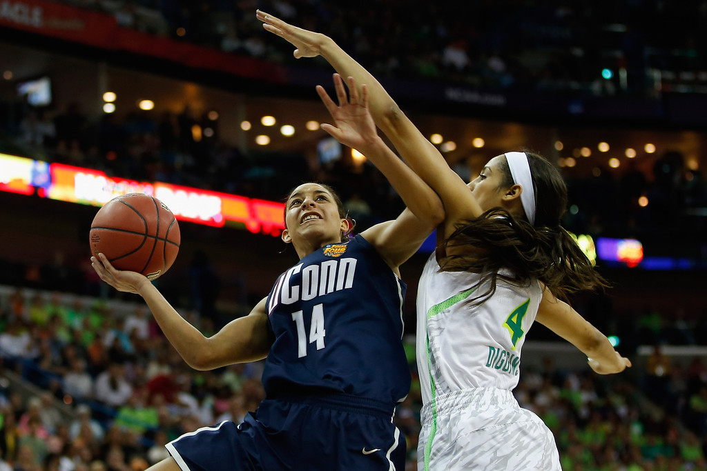 Description of . Bria Hartley #14 of the Connecticut Huskies shoots the ball over Skylar Diggins #4 of the Notre Dame Fighting Irish during the National Semifinal game of the 2013 NCAA Division I Women\'s Basketball Championship at the New Orleans Arena on April 7, 2013 in New Orleans, Louisiana.  (Photo by Chris Graythen/Getty Images)