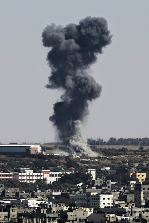 Description of . Smoke rises after an Israeli missile strike hit the northern Gaza Strip, Wednesday, July 16, 2014. Israeli war planes and naval vessels intensified attacks across the Gaza Strip on Wednesday, targeting senior Hamas leaders and bombarding a coastal area, where four Palestinian boys were killed. (AP Photo/Adel Hana)