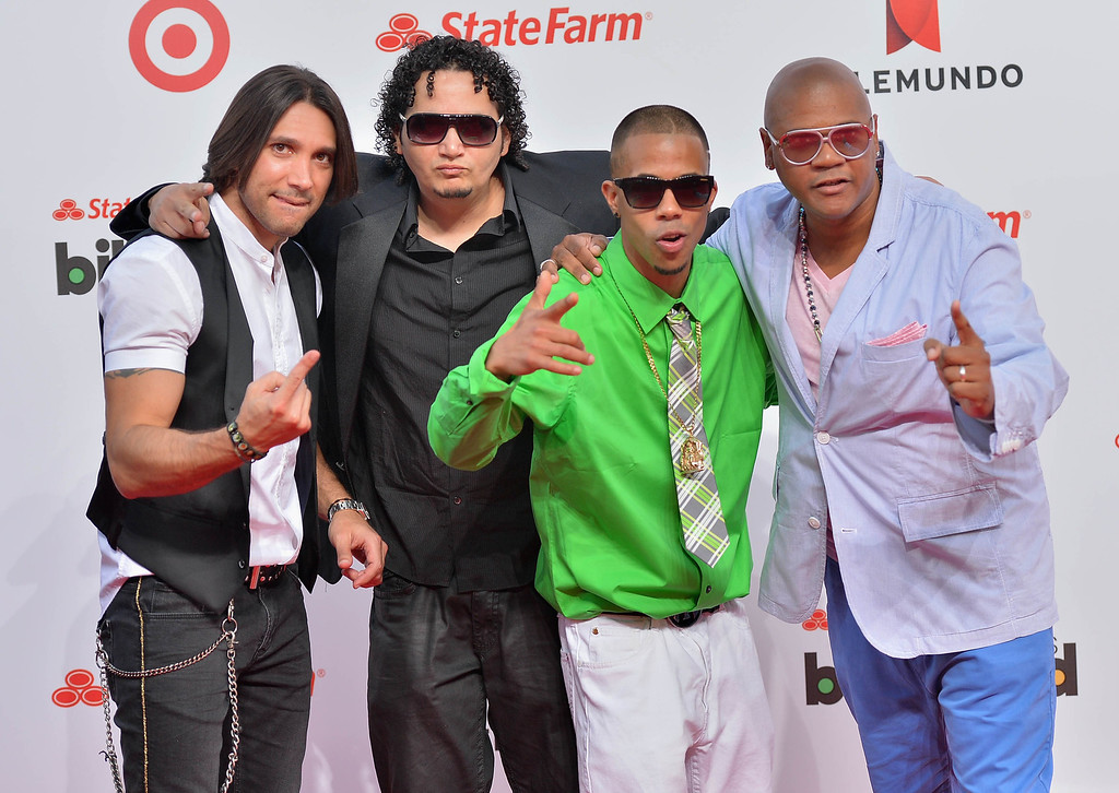 Description of . MIAMI, FL - APRIL 25:  Proyecto Uno arrive at Billboard Latin Music Awards 2013 at Bank United Center on April 25, 2013 in Miami, Florida.  (Photo by Gustavo Caballero/Getty Images)