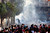 Egyptian protesters clash with riot police in downtown Cairo, Egypt, Saturday, March 9, 2013. Security officials say a protester has died during clashes between police and hundreds of stone-throwing demonstrators in central Cairo.(AP Photo/Nasser Nasser)