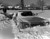 A man trying to dig out his car after the Blizzard of '82. Denver Post Library Archive
