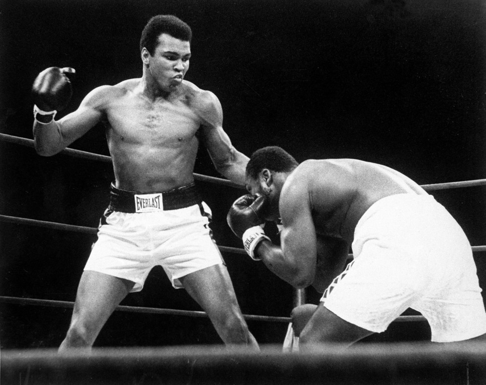 Description of . Muhammad Ali throws  a punch at Joe Frazier, right, during their bout at Madison Square Garden in New York, Jan. 28, 1974. Ali's hometown of  Louisville is ready to unveil a museum celebrating the life of one of the 20th century's most recognizable figures.  The Muhammad Ali Center is to open Nov. 21,2005, chronicling the life of