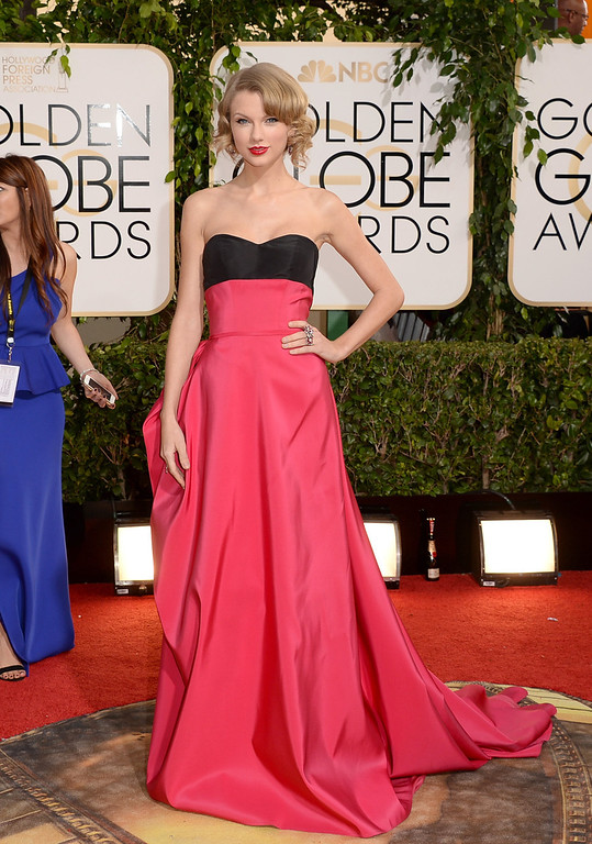 Description of . Singer Taylor Swift attends the 71st Annual Golden Globe Awards held at The Beverly Hilton Hotel on January 12, 2014 in Beverly Hills, California.  (Photo by Jason Merritt/Getty Images)