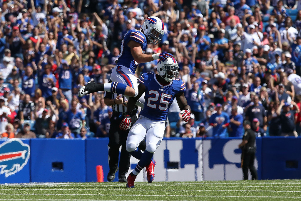 Description of . Da'Norris Searcy #25 of the Buffalo Bills celebrates a sack with Kiko Alonso #50 during NFL game action against the New England Patriots at Ralph Wilson Stadium on September 8, 2013 in Orchard Park, New York. (Photo by Tom Szczerbowski/Getty Images)