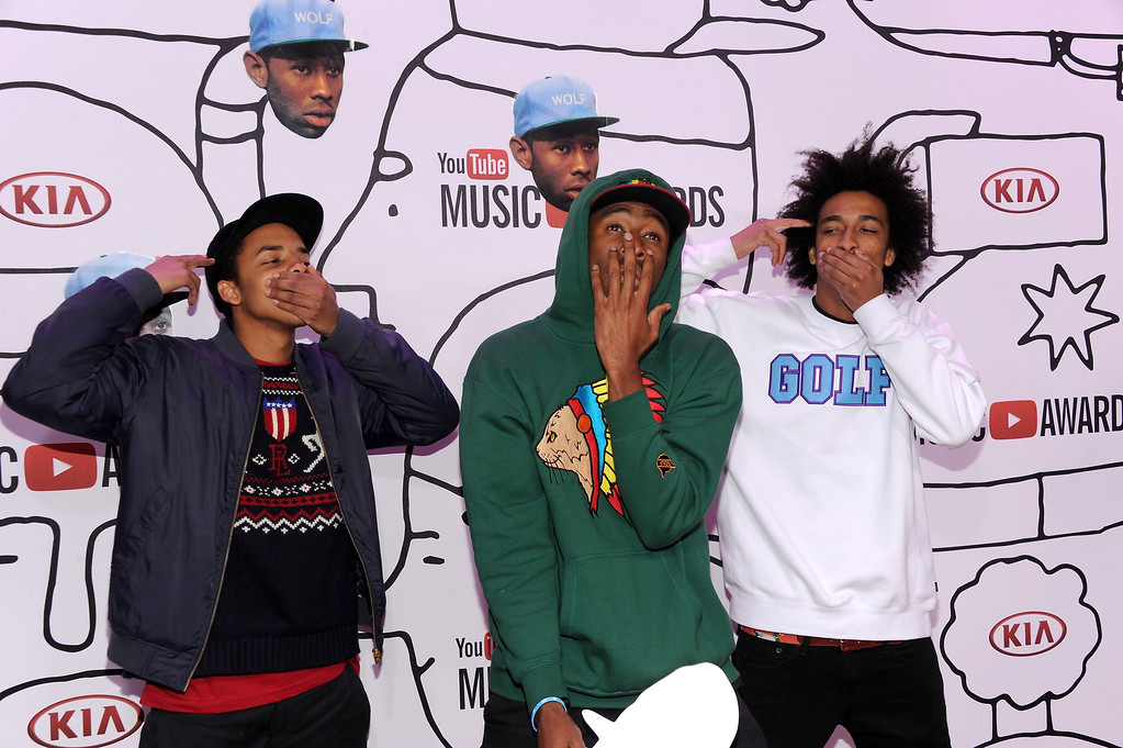 Description of . L-R) Earl Sweatshirt, Tyler The Creator and Taco Bennett attend the YouTube Music Awards 2013 on November 3, 2013 in New York City.  (Photo by Dimitrios Kambouris/Getty Images)