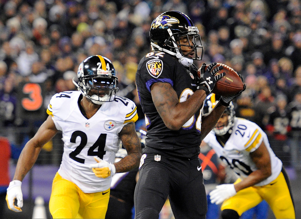 Description of . Baltimore Ravens wide receiver Torrey Smith, center, makes a touchdown catch in front of Pittsburgh Steelers cornerback Ike Taylor (24) and strong safety Will Allen in the first half of an NFL football game on Thursday, Nov. 28, 2013, in Baltimore. (AP Photo/Nick Wass)