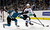 San Jose Sharks center Joe Thornton (19) lunges for the puck next to Colorado Avalanche defenseman Erik Johnson (6) during the first period of an NHL hockey game in San Jose, Calif., Saturday, Jan. 26, 2013. (AP Photo/Marcio Jose Sanchez)