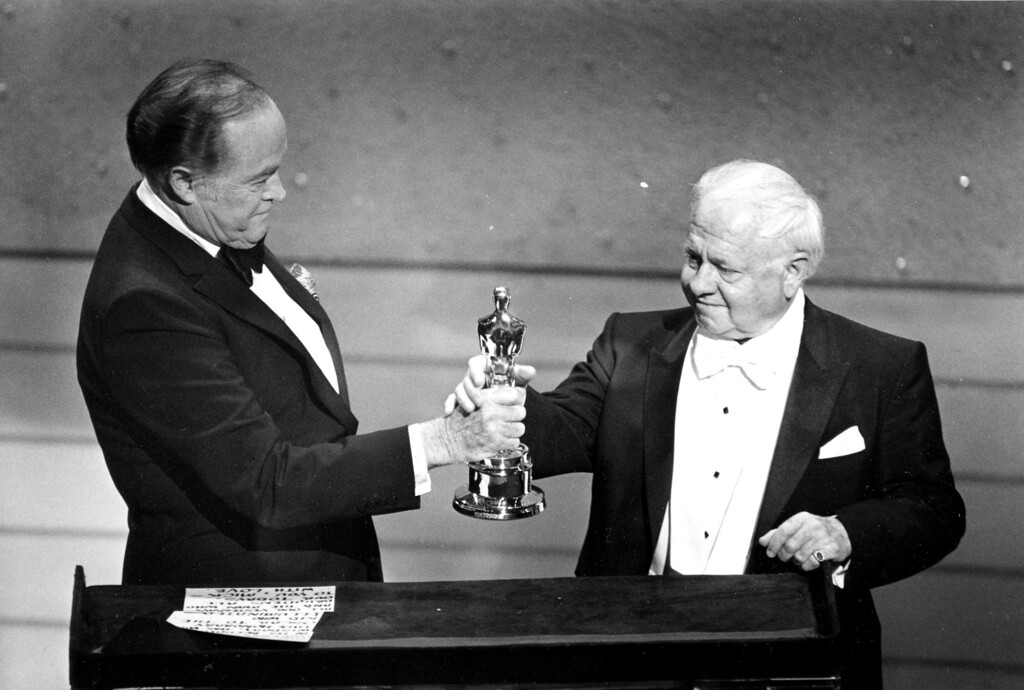 Description of . Entertainer Bob Hope, left, presents the Honorary Oscar for Lifetime Achievement to actor Mickey Rooney at the 55th Annual Academy Awards ceremony in Los Angeles, Ca., April 10, 1983.  Rooney is honored for his 60 years of contribution to the motion picture industry.  (AP Photo)