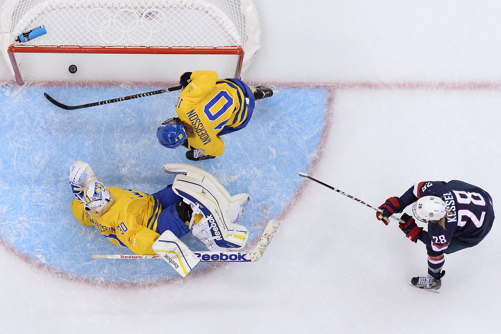 Description of . Sweden's Emilia Andersson (#10) scores against her team during the Women's Ice Hockey Semifinals USA vs Sweden at the Shayba Arena during the Sochi Winter Olympics on February 17, 2014.    JONATHAN NACKSTRAND/AFP/Getty Images