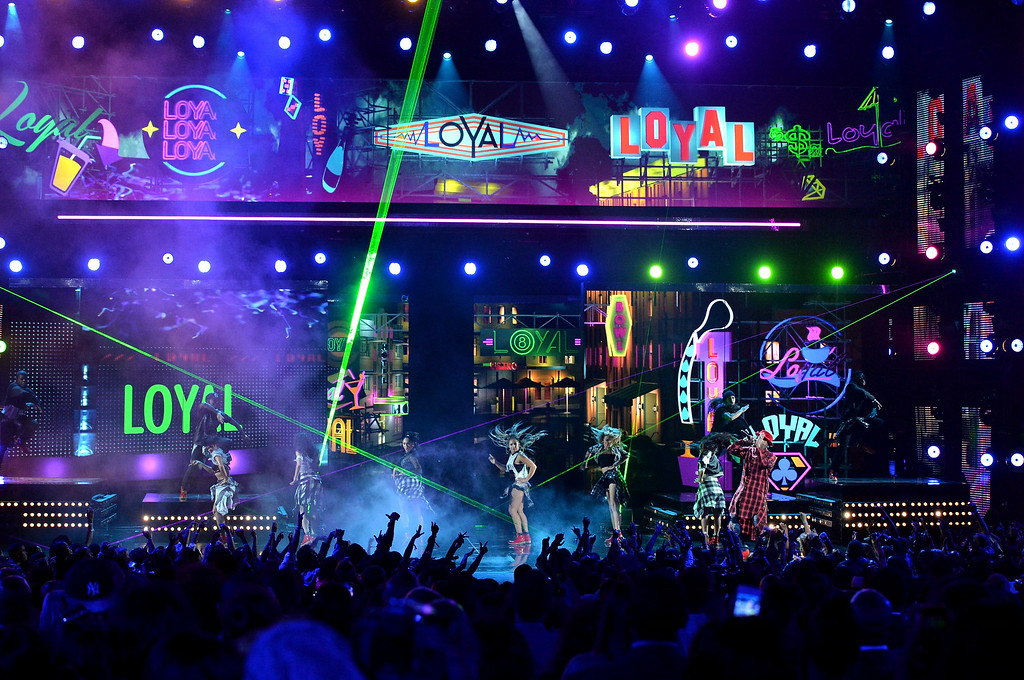 Description of . Singer Chris Brown performs onstage during the BET AWARDS '14 at Nokia Theatre L.A. LIVE on June 29, 2014 in Los Angeles, California.  (Photo by Kevin Winter/Getty Images for BET)