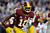 LANDOVER, MD - DECEMBER 03:  Robert Griffin III #10 of the Washington Redskins scrambles with the ball in the second half against the New York Giants at FedExField on December 3, 2012 in Landover, Maryland.  (Photo by Patrick McDermott/Getty Images)
