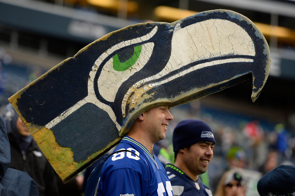 . Seattle Seahawks fan Matthew Frey of DeWitt, Iowa, wears a 4-1/2-foot Seahawks hat before the NFC championship game at CenturyLink Field in Seattle on Sunday, Jan. 19, 2014. (Jose Carlos Fajardo/Contra Costa Times/MCT)