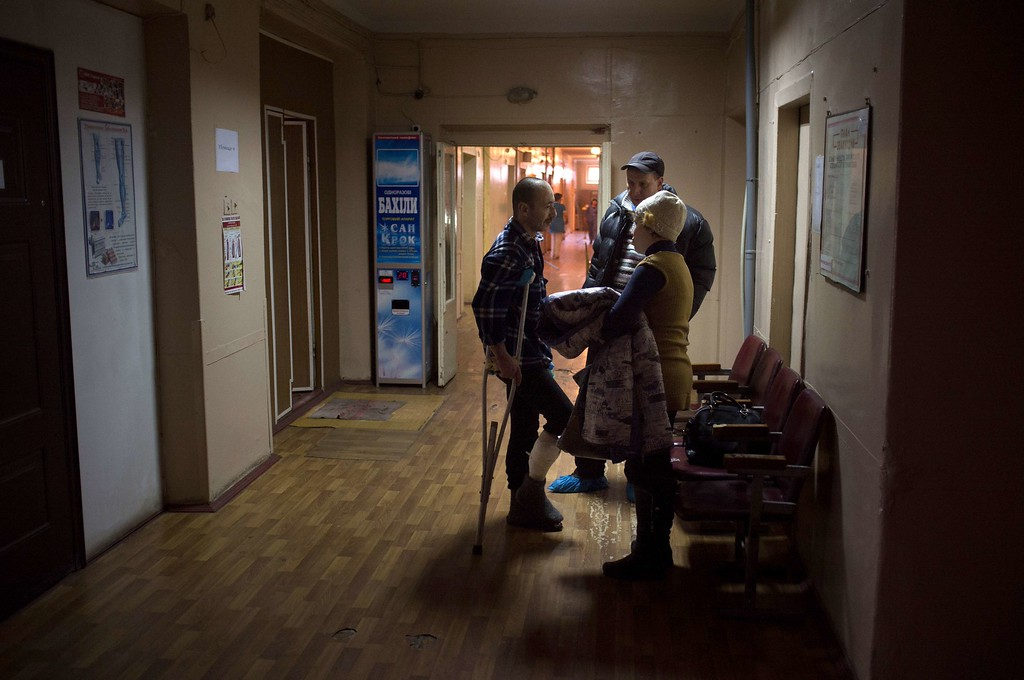 Description of . People visit their relatives wounded as a result of shelling in southern Ukrainian city of Mariupolon January 24 at an emergency hospital on January 26, 2015. The EU and NATO called on Russia to end its support for rebels in Ukraine, with Brussels mulling an emergency meeting after at least 30 people were killed in the port of Mariupol in a major escalation of the fighting. Oleksandr Stashevskiy/AFP/Getty Images