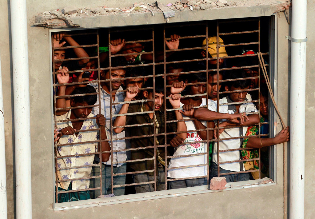 Description of . People watch rescue operations after the Rana Plaza building collapsed, in Savar, 30 km (19 miles) outside Dhaka April 24, 2013.REUTERS/Andrew Biraj