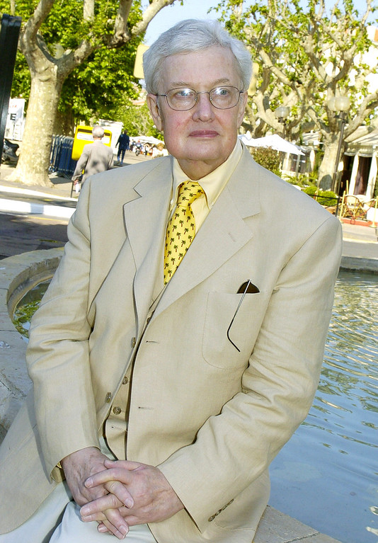 Description of . This May 17, 2004 file photo shows Pulitzer Prize winning film critc Roger Ebert at the 57th International Film Festival in Cannes, southern France. (AP Photo/Michel Euler, file)