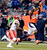 Denver Broncos wide receiver Demaryius Thomas (88) catches a pass over Kansas City Chiefs cornerback Javier Arenas (21) during the fourth quarter. The Denver Broncos vs Kansas City Chiefs at Sports Authority Field Sunday December 30, 2012. Joe Amon, The Denver Post
