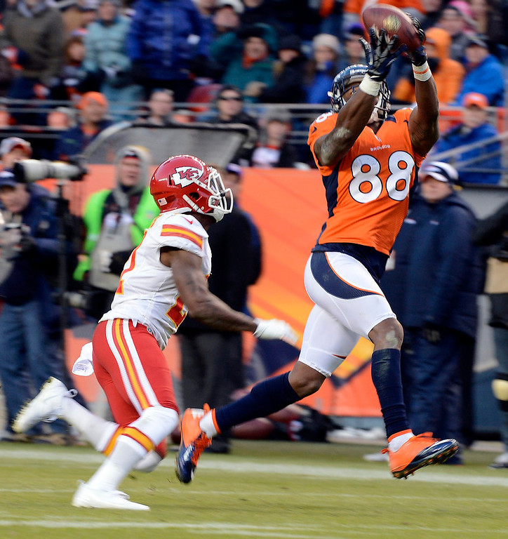 Description of . Denver Broncos wide receiver Demaryius Thomas (88) catches a pass over Kansas City Chiefs cornerback Javier Arenas (21) during the fourth quarter. The Denver Broncos vs Kansas City Chiefs at Sports Authority Field Sunday December 30, 2012. Joe Amon, The Denver Post