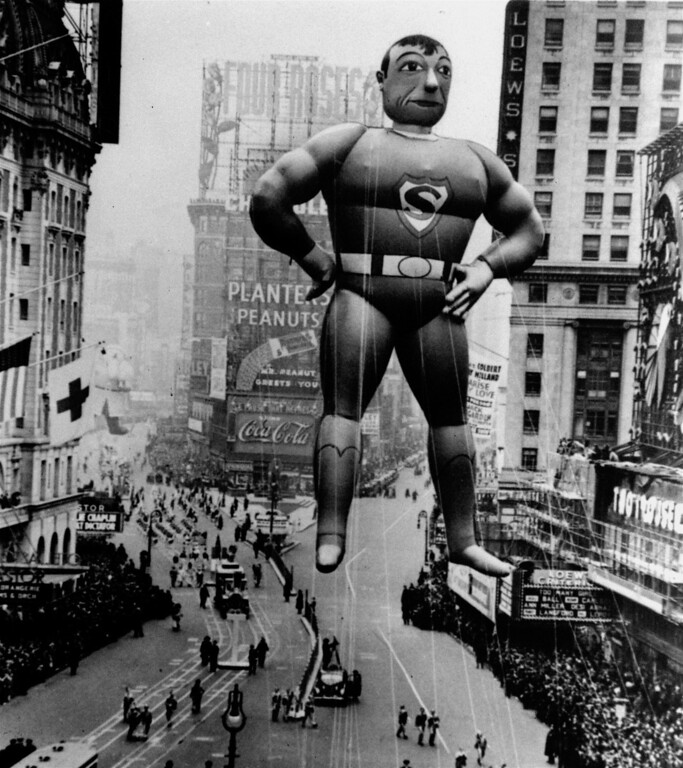 Description of . A helium inflated Superman rises over the Times Square crowd to lead the Macy\'s Thanksgiving Day Parade in 1940.  (AP Photo/ho)