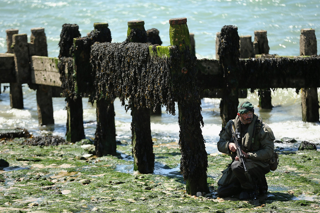 Description of . Members of the Royal Marines take part in an amphibious display on Southsea Beach as part of the commemoration of the D-day landings on June 5, 2014 in Portsmouth, England.  (Photo by Dan Kitwood/Getty Images)