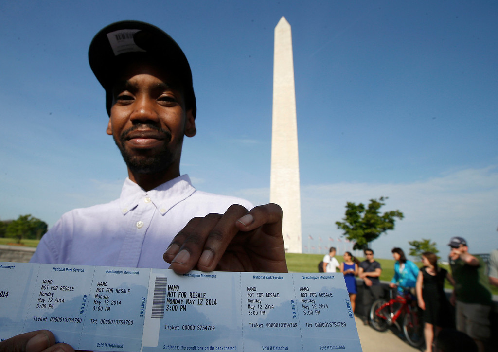 . Visitor Roman Tanner displays his Washington Monument ticket, which are distributed at on a first-come basis at the Washington Monument in Washington, Monday, May 12, 2014, ahead of a ceremony to celebrate its re-opening.  (AP Photo)