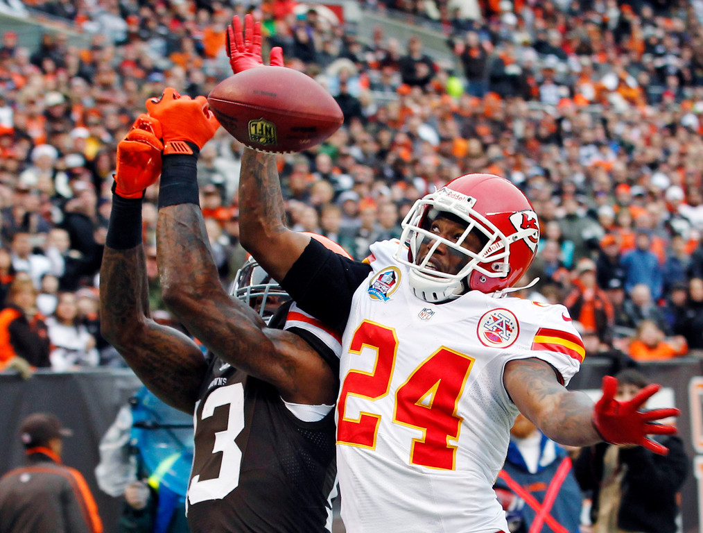 Description of . Kansas City Chiefs cornerback Brandon Flowers (24) breaks up a pass in the end zone intended for Cleveland Browns wide receiver Josh Gordon in the first quarter of an NFL football game, Sunday, Dec. 9, 2012, in Cleveland. (AP Photo/Tony Dejak)