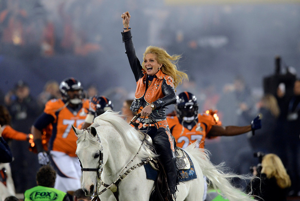 Description of . Ann Judge-Wegener rides Thunder into the stadium.  The Denver Broncos vs the Seattle Seahawks in Super Bowl XLVIII at MetLife Stadium in East Rutherford, New Jersey Sunday, February 2, 2014. (Photo by AAron Ontiveroz/The Denver Post)