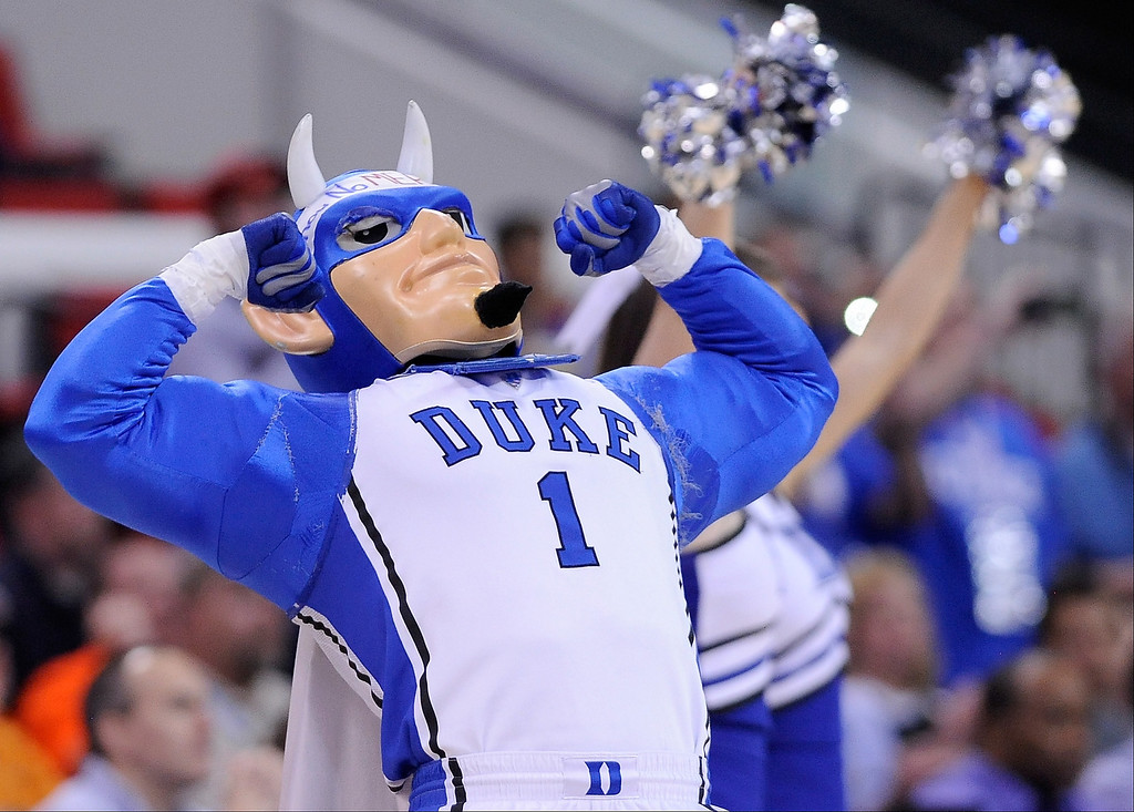 Description of . The Duke Blue Devils mascot flexes in the first half as the Blue Devils take on the Mercer Bears in the second round of the 2014 NCAA Men's Basketball Tournament at PNC Arena on March 21, 2014 in Raleigh, North Carolina.  (Photo by Grant Halverson/Getty Images)