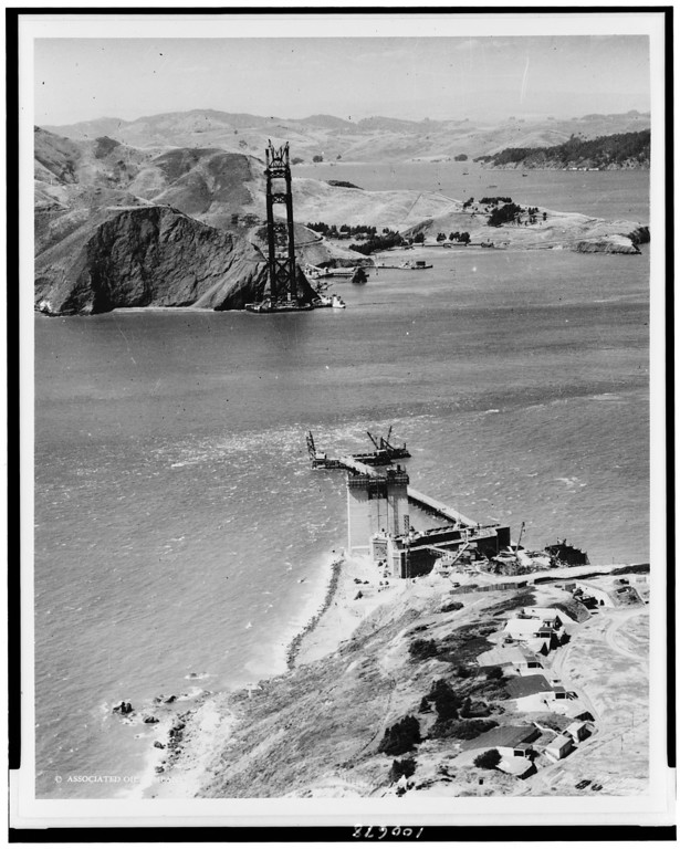 Description of . The Golden Gate Bridge under construction, c1934. (Photo by Chas. M. Hiller, Library of Congress)