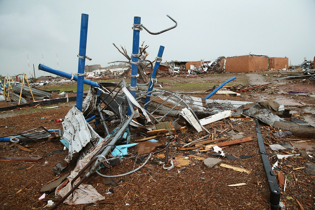 Description of . MOORE, OK - MAY 23: Playground equipment is twisted after a tornado ripped through the area outside of the Plaza Towers Elementary School on May 23, 2013 in Moore, Oklahoma. Seven children died in the school during the tornado. The two-mile-wide Category 5 tornado touched down May 20 killing at least 24 people and leaving behind extensive damage to homes and businesses. U.S. President Barack Obama promised federal aid to supplement state and local recovery efforts. (Photo by Scott Olson/Getty Images)