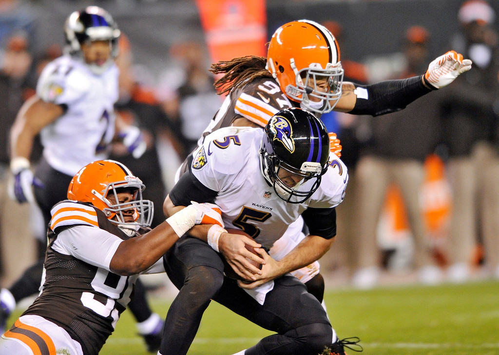 . Cleveland Browns defensive end Armonty Bryant, left, and outside linebacker Jabaal Sheard (97) sack Baltimore Ravens quarterback Joe Flacco (5) in the second quarter of an NFL football game Sunday, Nov. 3, 2013. (AP Photo/David Richard)