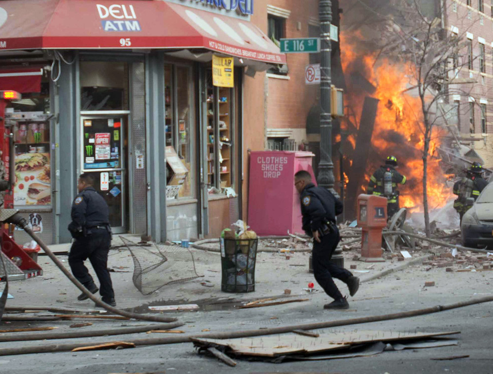 Description of . Emergency crews respond to an explosion that leveled two apartment buildings in the East Harlem neighborhood of New York, Wednesday, March 12, 2014. The blast happened after a neighbor reported smelling natural gas. (AP Photo/Jeremy Sailing)