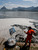 A municipal worker collects dead fish at the Rodrigo de Freitas lagoon in Rio de Janeiro, March 13, 2013.  REUTERS/Sergio Moraes