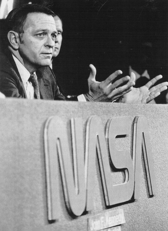 . Jesse Moore, chief of NASA\'s space shuttle program, answers reporters \' questions during a news conference 1/29 where he refused to speculate on the cause of the tragic Challenger explosion 1/28. Credit: UPI