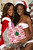 Avionne Mark of Trinidad & Tobago and Celeste Marshall of Bahamas pose for photographs as part of preparations for the Miss Universe 2012 pageant in Las Vegas, Nevada December 4, 2012. The pageant, will be held on December 19, 2012 at the Planet Hollywood Resort & Casino in Las Vegas. REUTERS/Valerie Macon/Handout