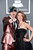 Musician Josh Ramsay (L) and Amanda McEwan arrive at the 55th Annual GRAMMY Awards at Staples Center on February 10, 2013 in Los Angeles, California.  (Photo by Jason Merritt/Getty Images)