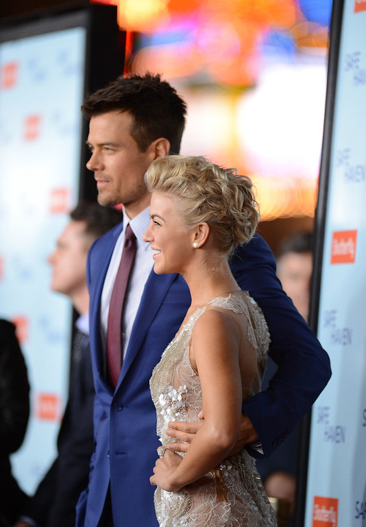 Description of . Actors Julianne Hough and Josh Duhamel arrive at the premiere of Relativity Media's 'Safe Haven' at TCL Chinese Theatre on February 5, 2013 in Hollywood, California.  (Photo by Jason Merritt/Getty Images)