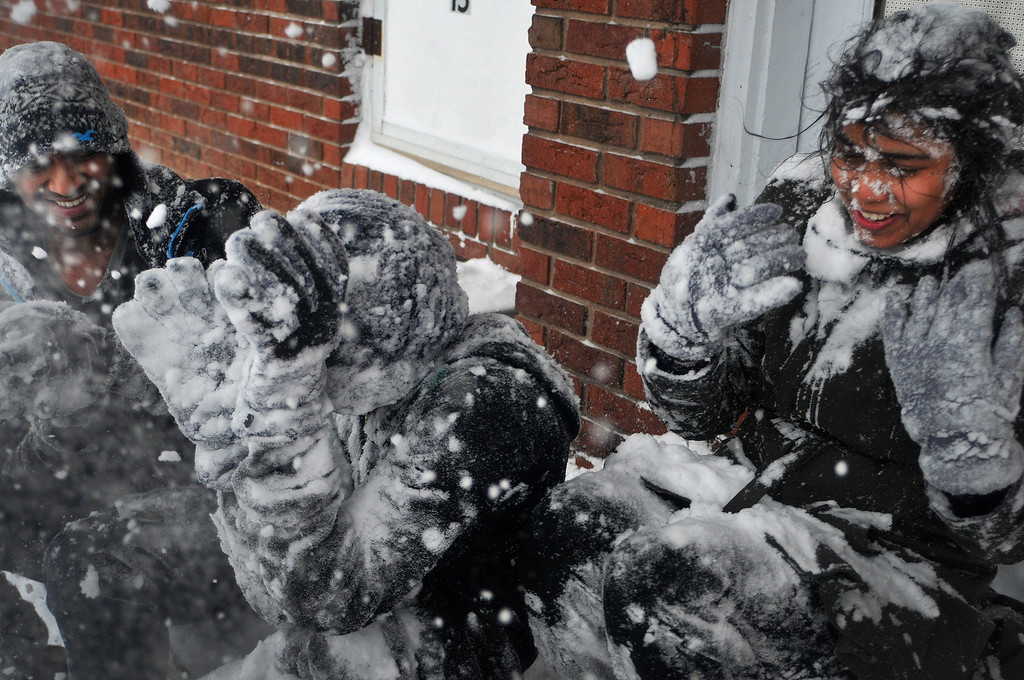 Description of . From left, Rishi Gottikonda, Hareendra Bandaru and Revathi Irrigineni play in the snow for the first time ever in their lives after heavy snowfall moved through the area on Dec. 6, 2013, in Carbondale, Ill. (AP Photo/The Southern, Steve Matzker)