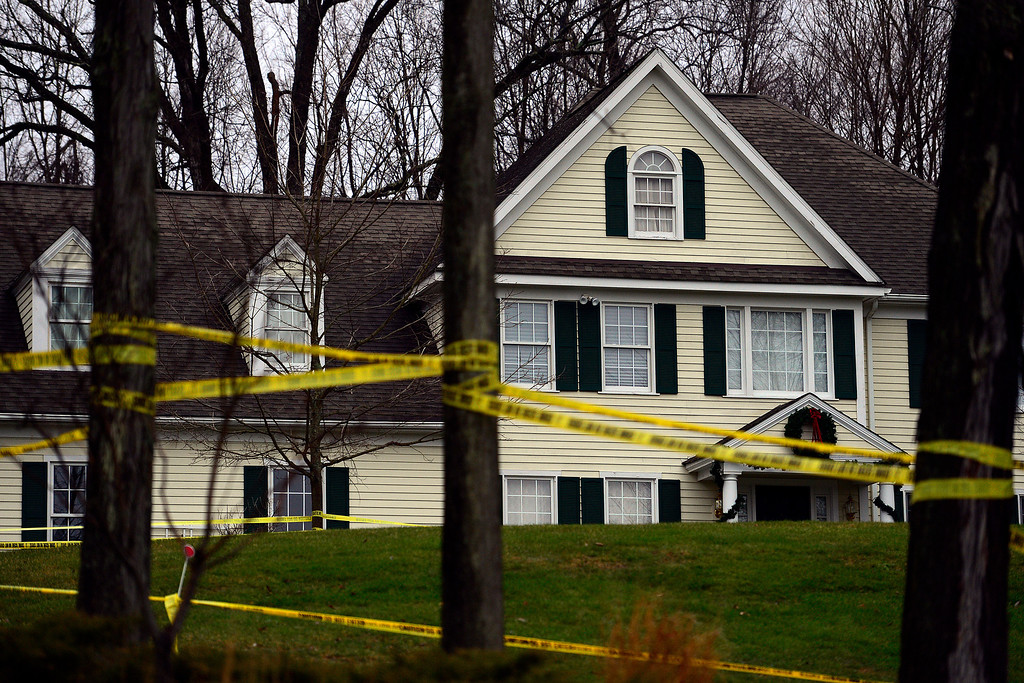 Description of . Police officers man the home of Adam Lanza, who shot at killed 26 people (20 children, 6 adults) at Sandy Hook school last Friday in Newtown, Connecticut on Tuesday, December 18, 2012. AAron Ontiveroz, The Denver Post