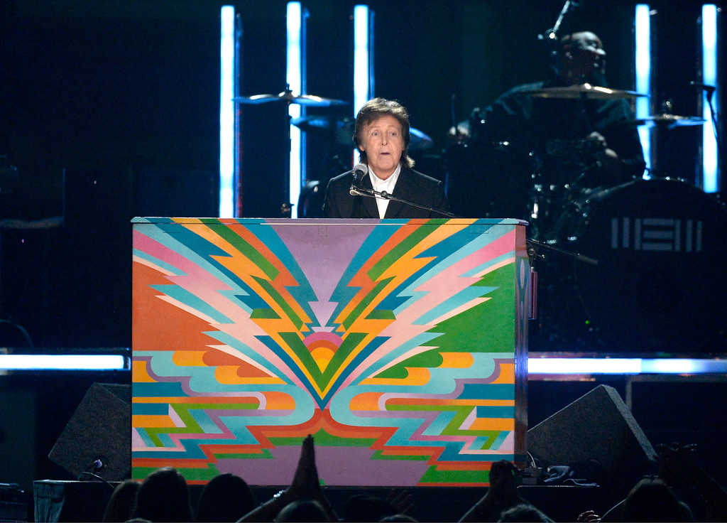 Description of . Musician Paul McCartney performs onstage during the 56th GRAMMY Awards at Staples Center on January 26, 2014 in Los Angeles, California.  (Photo by Kevork Djansezian/Getty Images)