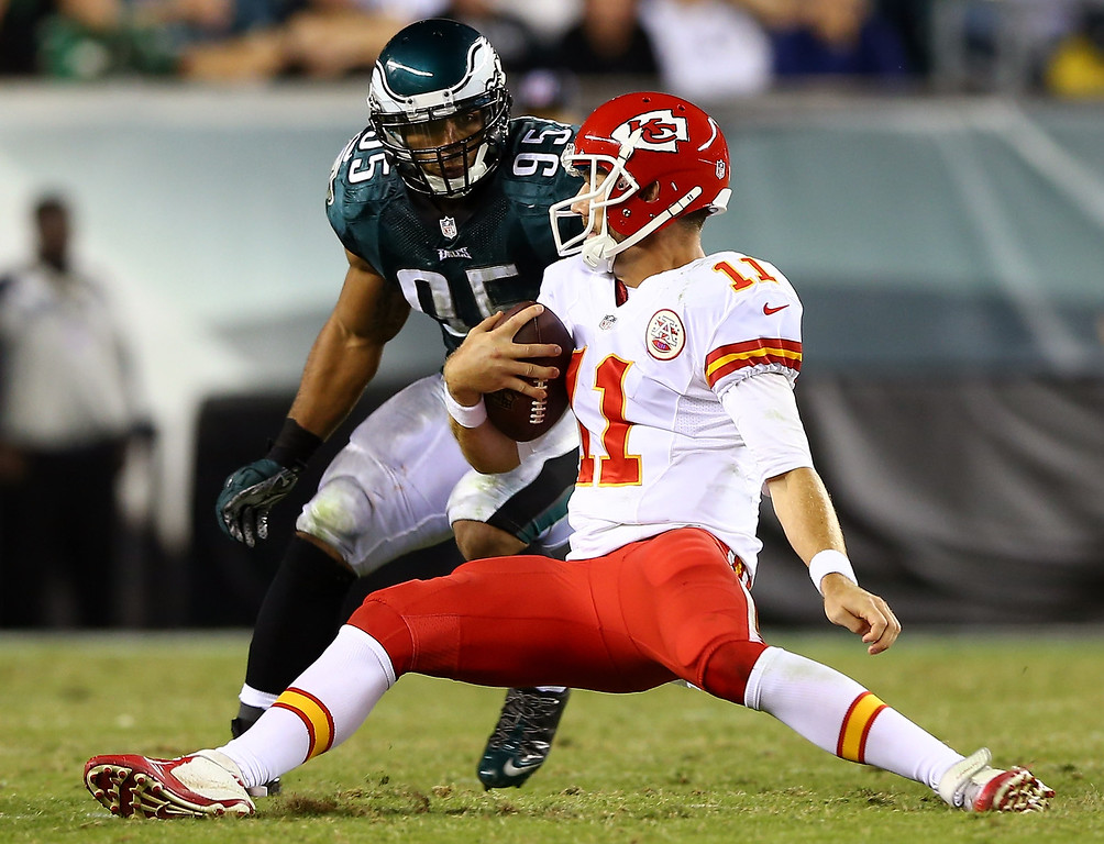Description of . Mychal Kendricks #95 of the Philadelphia Eagles looks to tackle Alex Smith #11 of the Kansas City Chiefs in the second quarter at Lincoln Financial Field on September 19, 2013 in Philadelphia, Pennsylvania.  (Photo by Elsa/Getty Images)