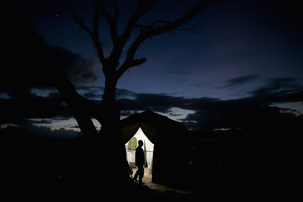 Description of . A man is framed in the doorway as he leaves an aid tent on November 16, 2013 in Leyte, Philippines.   (Photo by Dan Kitwood/Getty Images)