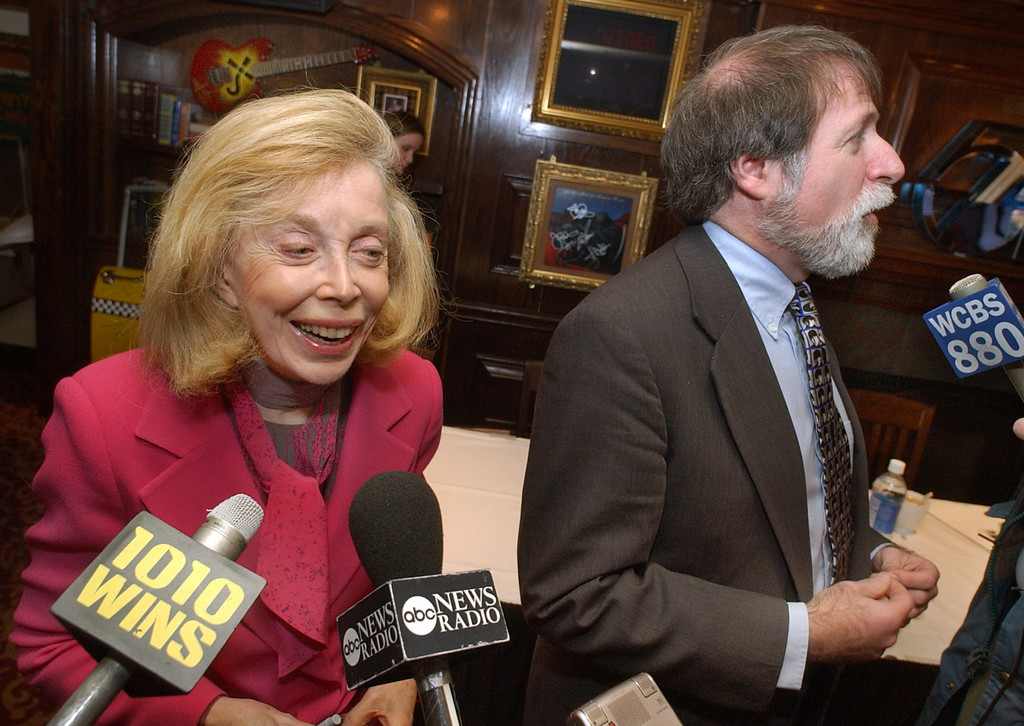 "Description of . Psychologist Dr. Joyce Brothers and Bruce Spizer, author of ""The Beatles are Coming,\"" are interviewed at a New York news conference Friday, Jan. 16, 2004. The Fab 40 Committee, a loosely-knit group of Beatles fans and friends, held the conference to promote the events marking the famed Feb. 9, 1964, appearance by the Fab Four on \""The Ed Sullivan Show.\""  (AP Photo/Richard Drew)"